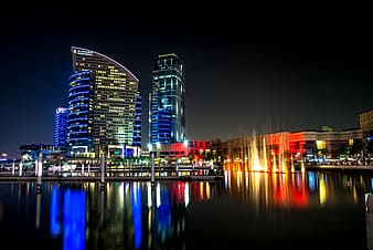 Photo of high raise buildings during nighttime
