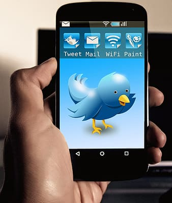 Black android smartphone displaying twitter application