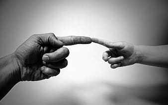Grayscale photography of two index fingers of two persons