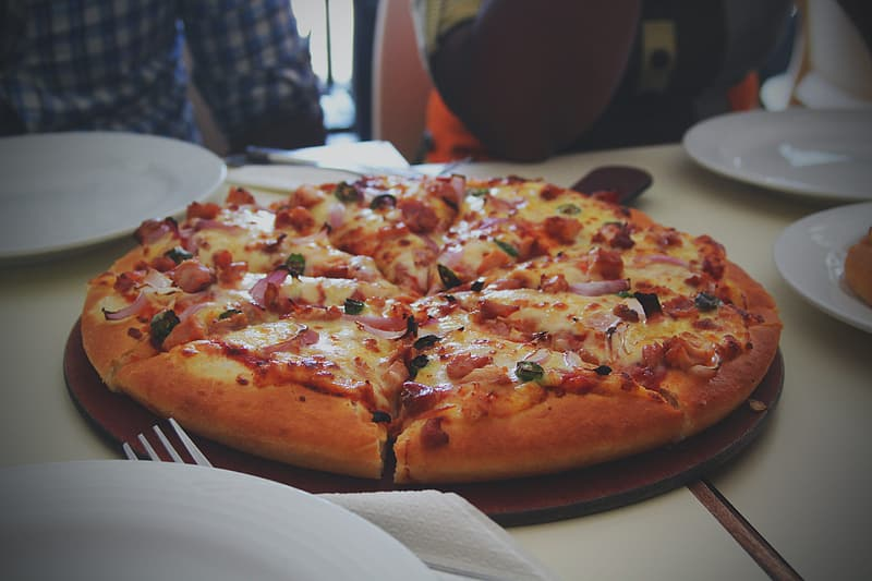 Baked pizza on table