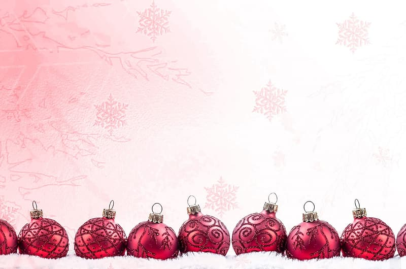 Red baubles on white textile