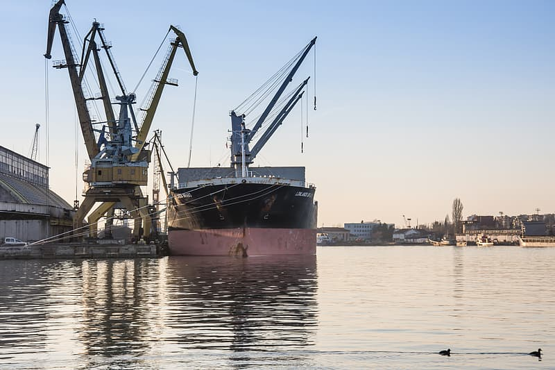 Black and gray cargo ship on body of water