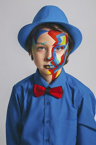 Man in blue dress shirt with blue white and red face paint