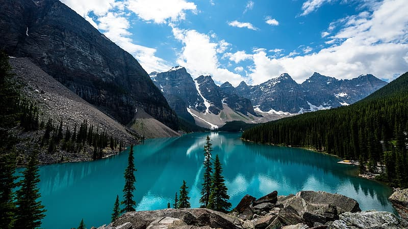 Clear body of water and mountain range view