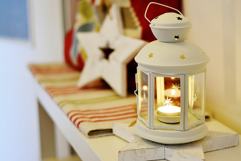 Selective focus photography of lighted candle lantern