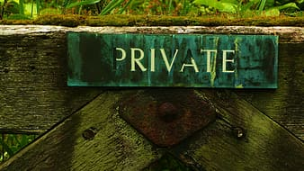 Private signage attached to wall