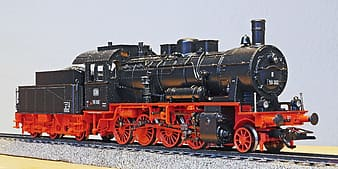 Red and black train on rail