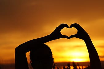 Silhouette of heart sign during sunset