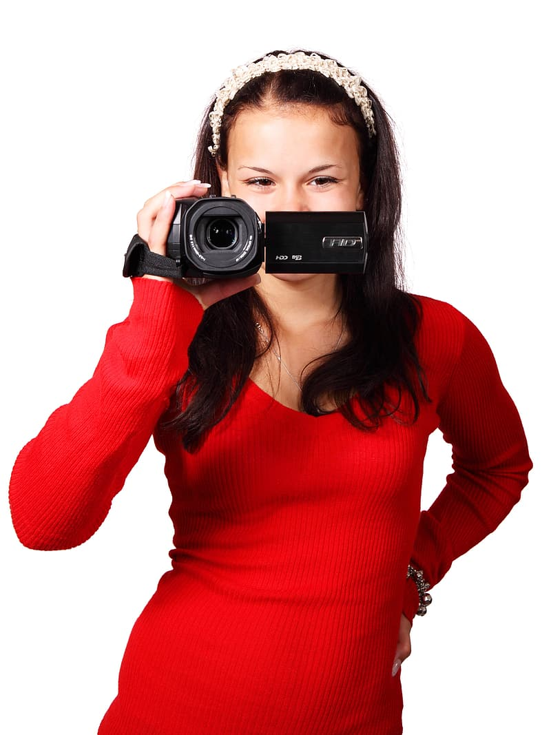 Woman wearing red long-sleeved shirt holding camcorder