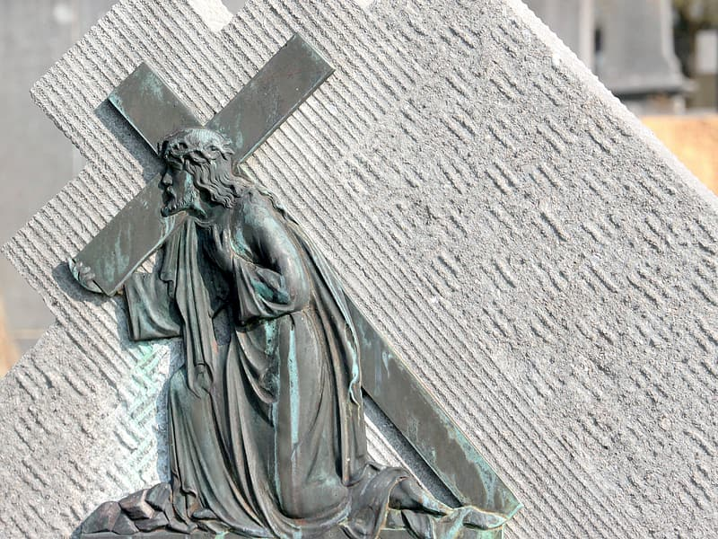 Jesus carrying cross on gray surface