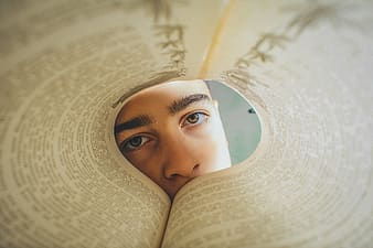 Woman in white hijab on book page