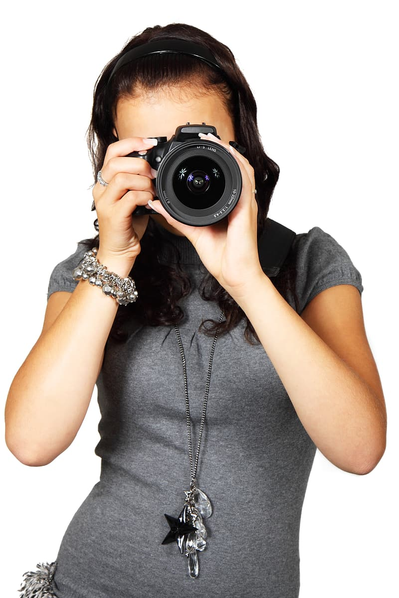 Woman holding DSLR taking photo
