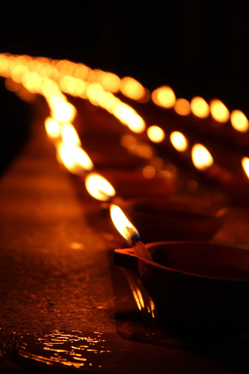 Selective focus photo of lighted candles