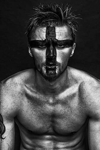 Topless man with black and white face paint