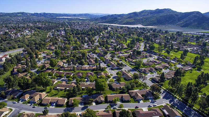 Aerial view photography of houses surrounded by trees during daytime
