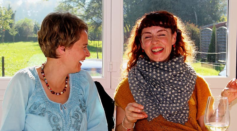 Two laughing women in well lit room