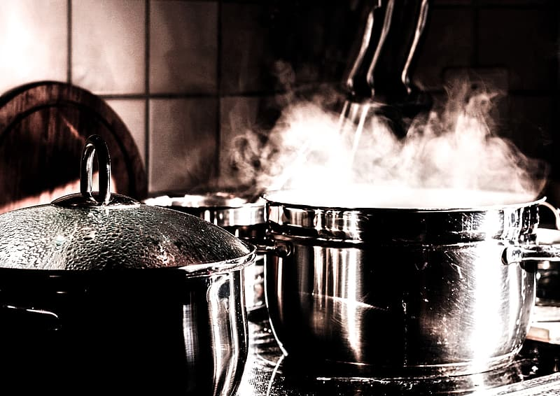 Boiling water on gray stainless steel cooking pot