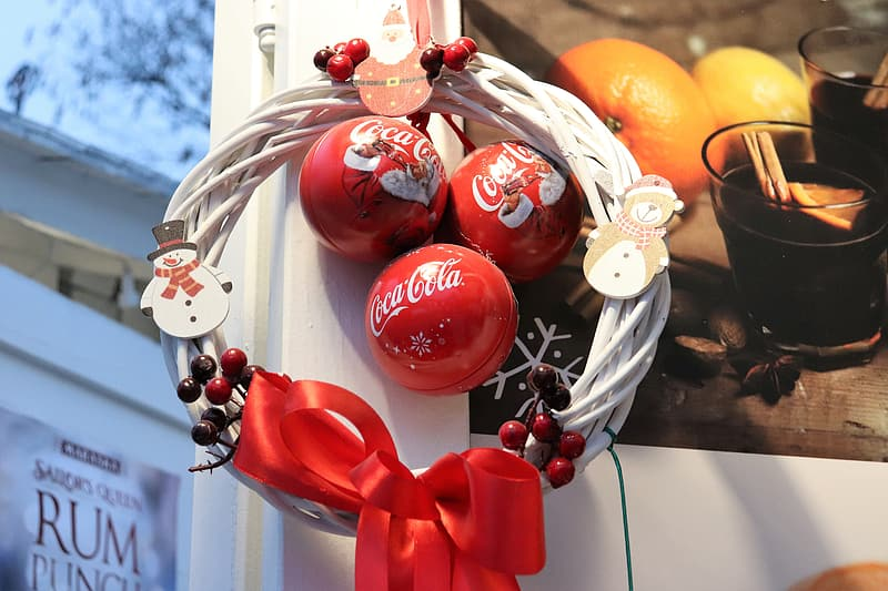 Red and gold baubles on white steel rack