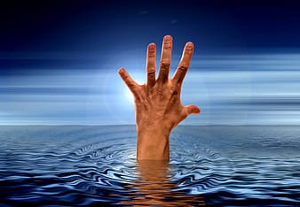 Photo of human hand on body of water