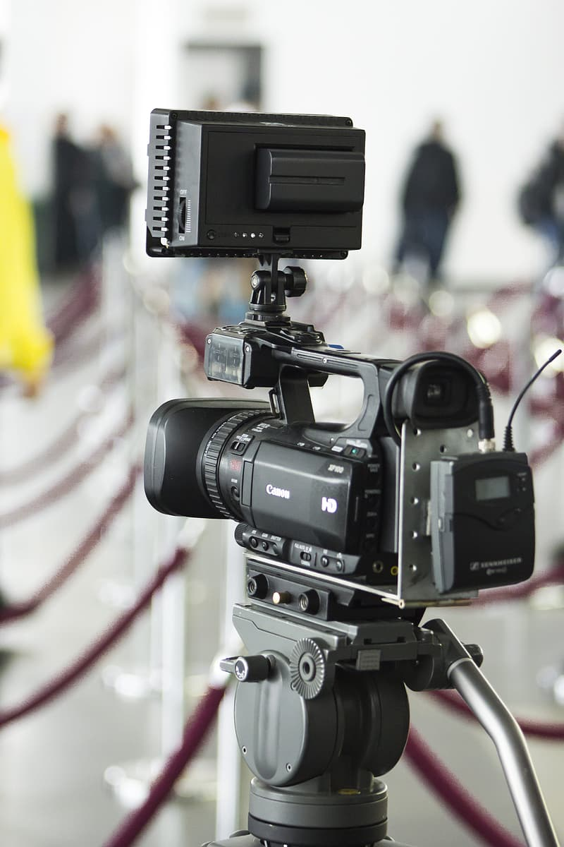 Selective focus photography of black video camera