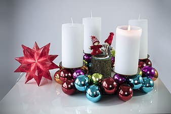 Red and green baubles with white pillar candles