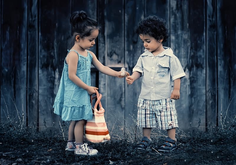 Boy and girl holding flower photo