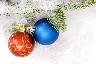 Blue and gold bauble on white and green christmas tree