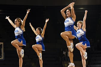 Four cheer dancers