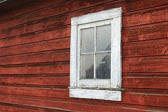 Closeup photo of white wooden framed clear glass window