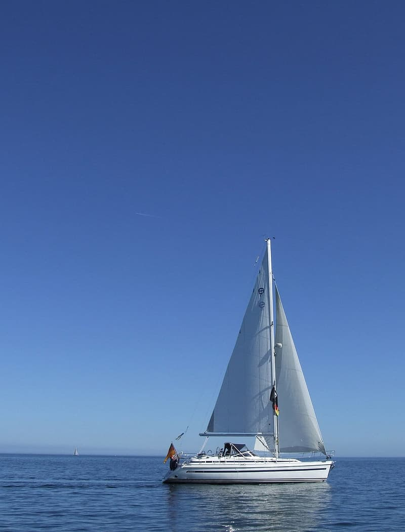 Sailboat on body of water \