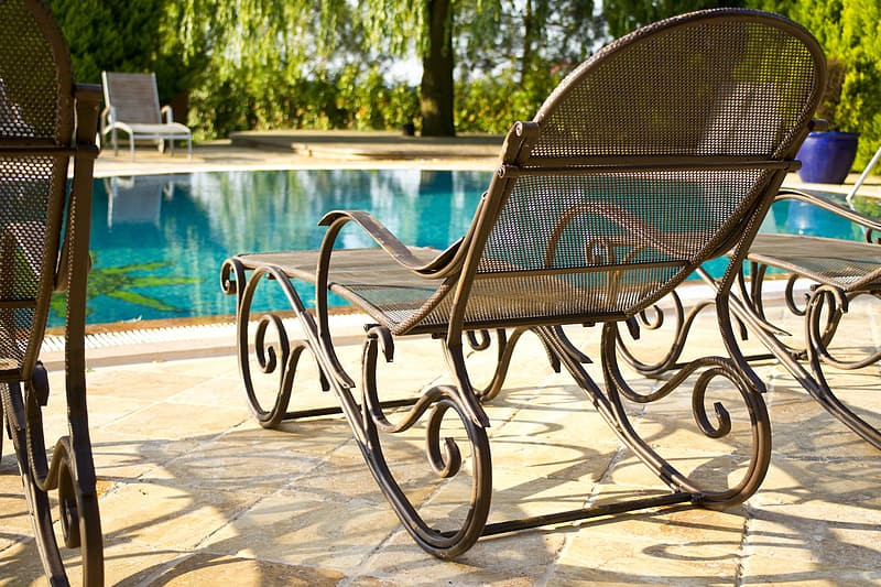 Lounge Chair With Pool Background