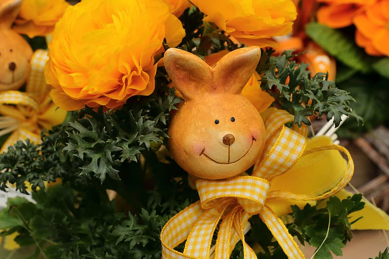 Yellow and red flowers with brown bear plush toy