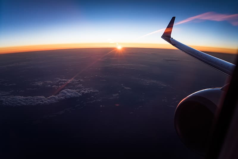 Airplane wing during sunset