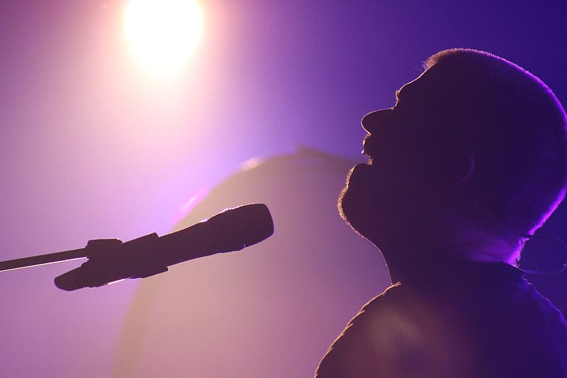 Silhouette of a man singing