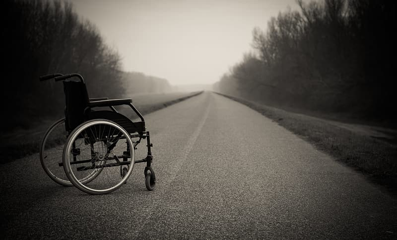 Black wheelchair on road during daytime