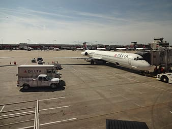 White and red passenger plane on airport during daytime