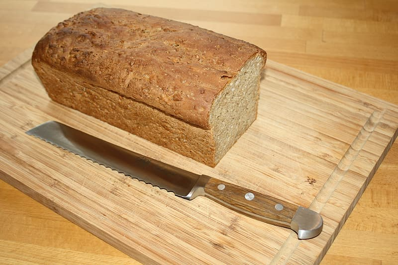 Loaf of bread on chopping board