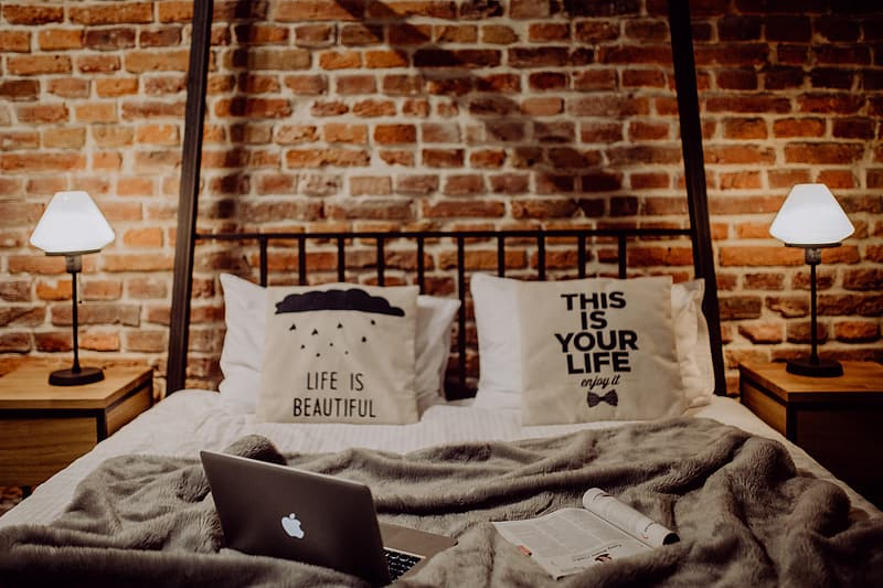 Enjoying evening with a Macbook in a nice bed