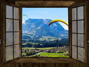 Man paragliding view front the window