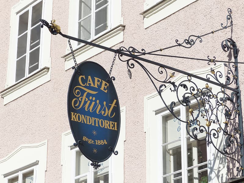 Cafe First store signage during daytime