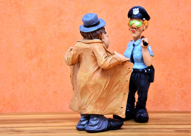 Police woman checking on man in brown coat figurines