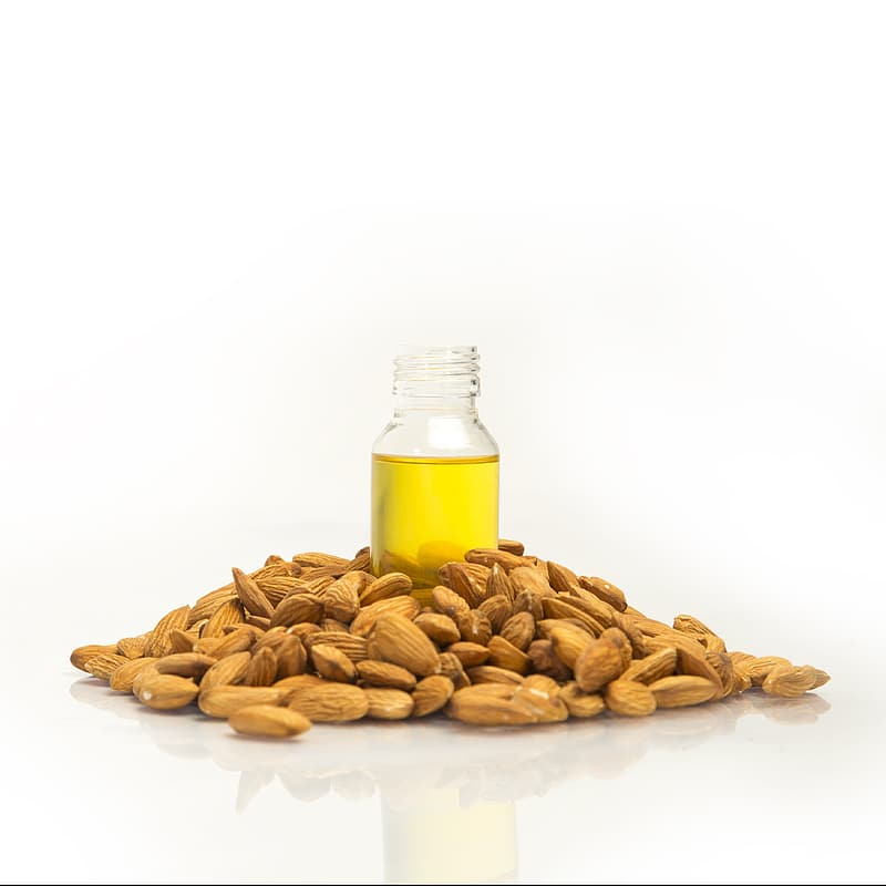 Brown peanuts on white surface