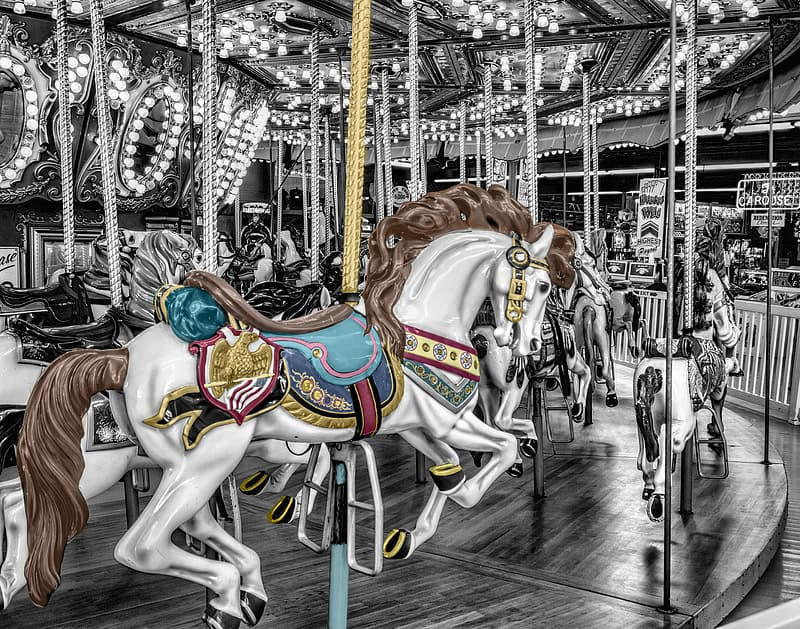 Selective color photo of carousel horse