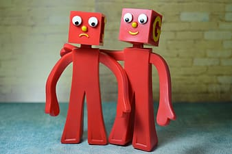 Photo of two red action figures