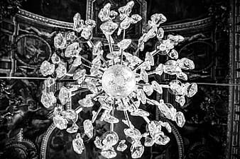 Grayscale photography of crystal stone chandelier