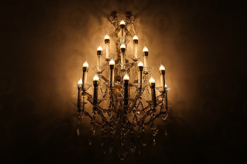 White and brown beaded uptight chandelier lighted up