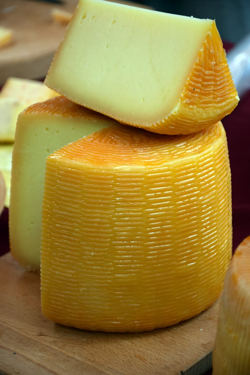 Sliced cheese on brown wooden surface