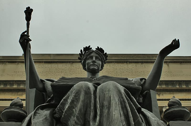 Woman sitting on chair statue