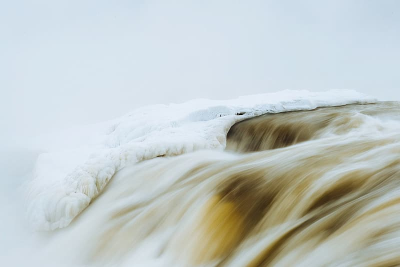 River on snowy mountain time lapsed photography
