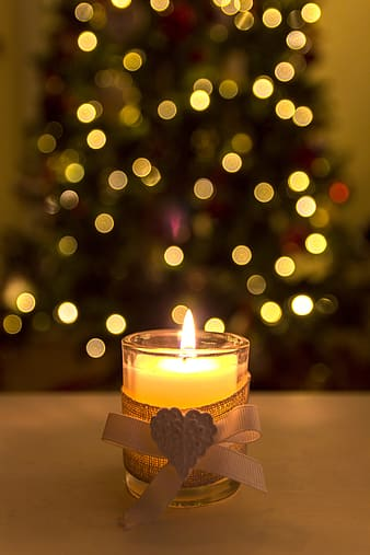 Lighted votive candle with bokeh lights